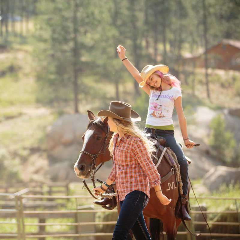 Lovin-her-horse-at-Lost-Valley-Ranch